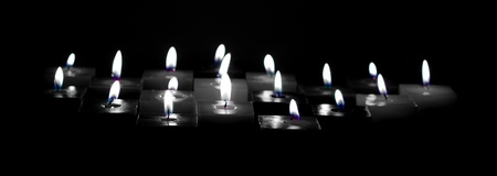 Closeup of burning candles on black background Stock Photo - 14118248