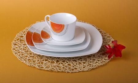 white and orange dinnerware  on a white background