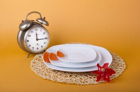 white and orange dinnerware  on a white background photo