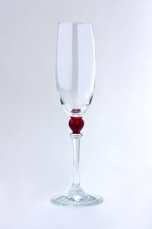 A glass of champagne on white background with soft shadow photo