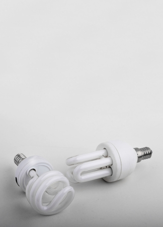 Energy saving lamp on white background   photo