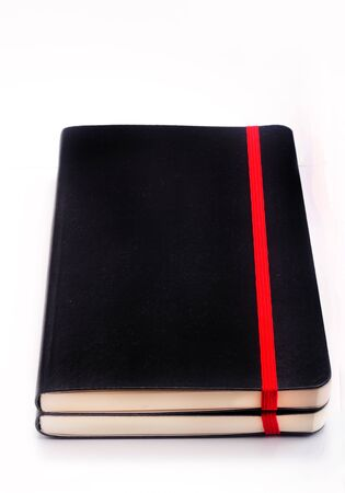 black color cover note book isolated on white background photo