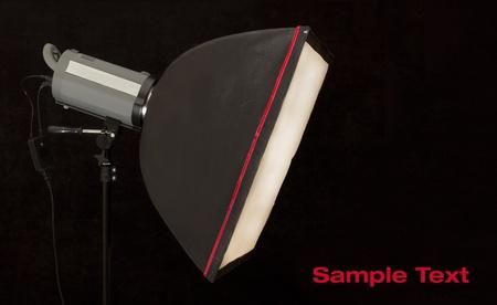 monolight: studio strobe with softbox on black background