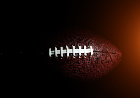 American football ball isolated on black background Stock Photo