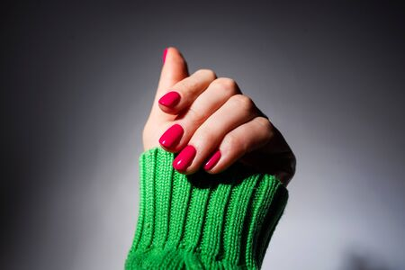 Nails Design. Hands With Pink Summer Manicure On Grey Background. Close Up Of Female Hands. Art Nail. Reklamní fotografie