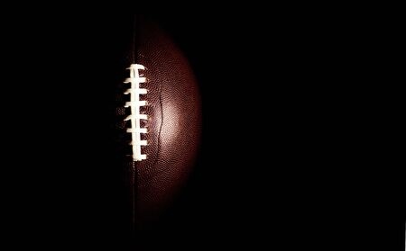 American football ball isolated on black background Stok Fotoğraf