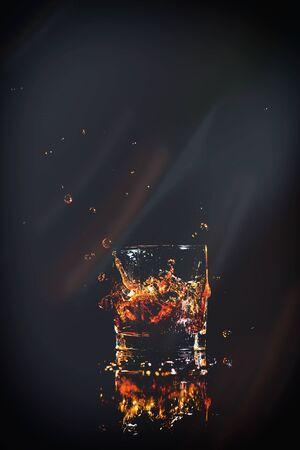 whiskey with splash on black background Stok Fotoğraf