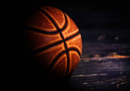 basketball ball on wooden background.