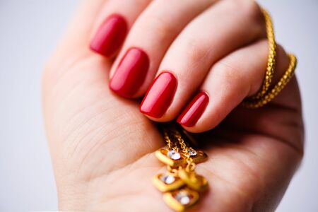 Nails Design. Hands With Bright Red Spring Manicure On Grey Background. Close Up Of Female Hands. Art Nail.