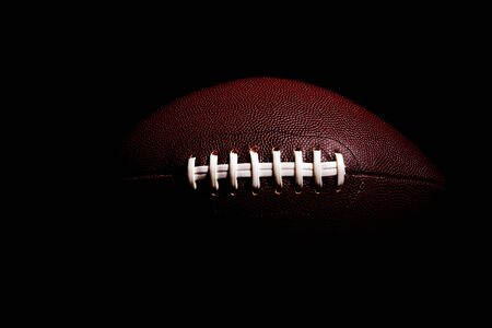 American football ball isolated on black background 写真素材