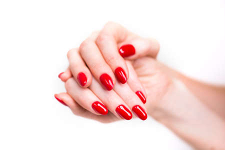 Nails Design. Hands With Bright Red Christmas Manicure On White Background. Close Up Of Female Hands. Art Nail. 版權商用圖片