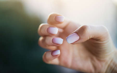Beautiful woman's nails with beautiful french manicure ombre peach and white 版權商用圖片
