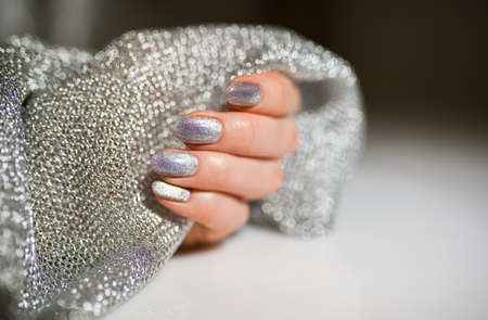 Nails Design. Hands With Bright Silver Christmas Manicure. Close Up Of Female Hands. Art Nail. 版權商用圖片