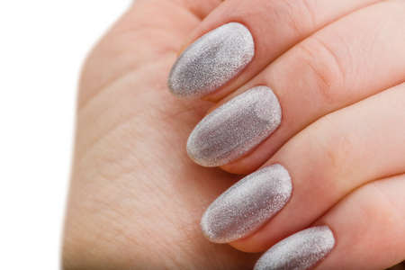 Nails Design. Hands With Bright Silver Christmas Manicure On White Background. Close Up Of Female Hands. Art Nail.