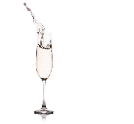 Glasses of champagne with splash, isolated on white background. 版權商用圖片