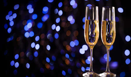 Christmas illuminations and champagne glass. Happy New Year. Christmas and New Year holidays background