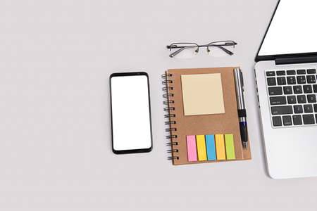 Laptop, smartphone, notebook and glasses. Working from home concept. 版權商用圖片