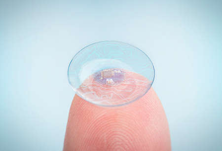 contact lens with digital and biometric implants. High Technologies in the future. 版權商用圖片