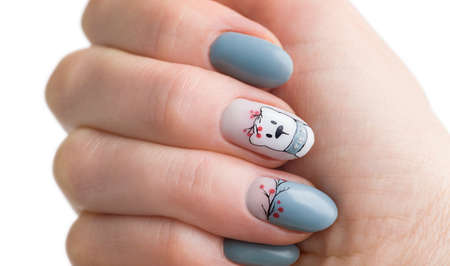 Nails Design. Hands. Christmas blue Manicure isolated on white Background. Close Up Of Female Hands. Art Nail.