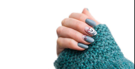Nails Design.  Christmas blue Manicure isolated on white Background. Close Up Of Female Hands. Art Nail. 版權商用圖片