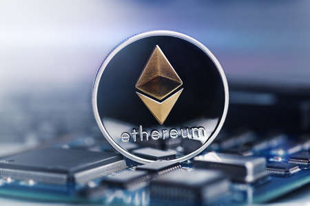 Ethereum crypto-currency on mainboard. Macro technology and computing concept. 版權商用圖片