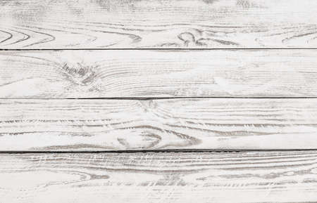 white-painted wooden panel, table background.