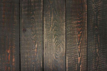 Brown wooden background, textured cutting board. 版權商用圖片