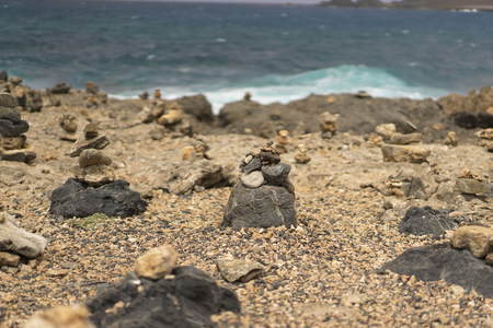 stormy sea: Stone piles at the shore with stormy sea in the back Stock Photo