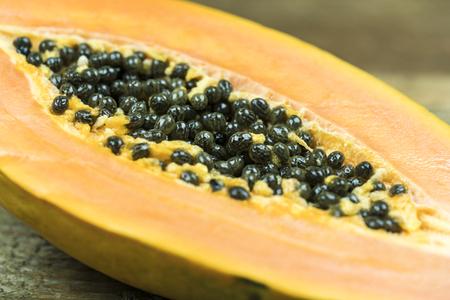 Close up view of papaya with numerous black seeds Standard-Bild