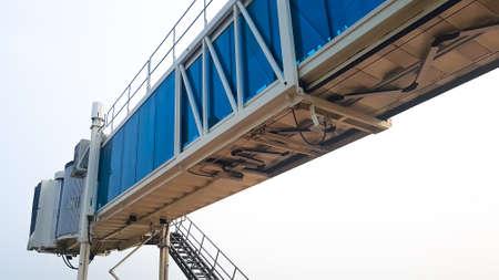 Airport terminal bridge on retracting for an aircraft Banco de Imagens