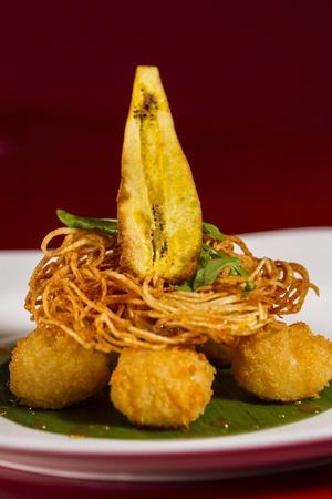tempura rice ball with rice needles and banana topping