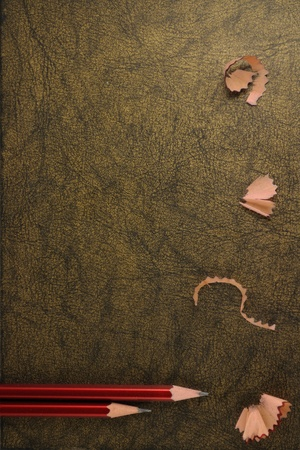 red pencils and wood shavings on grunge background Stock Photo - 9758556