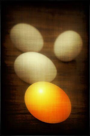 golden egg and white eggs on grunge background Stock Photo - 10223427