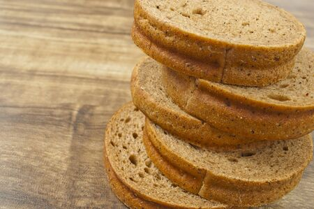 rye bread slices on a wooden table photo