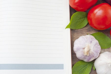 blank recipe and vegetables on a wooden table photo