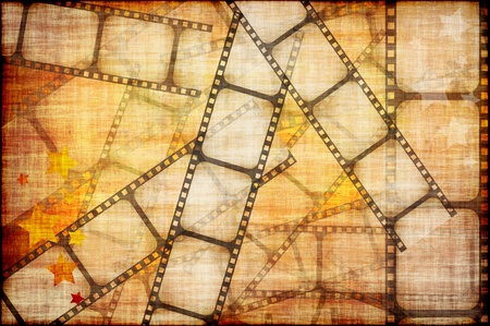 grunge background - film strip on a yellow background photo