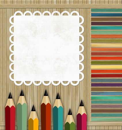 colored pencils on a wooden background with place for text photo