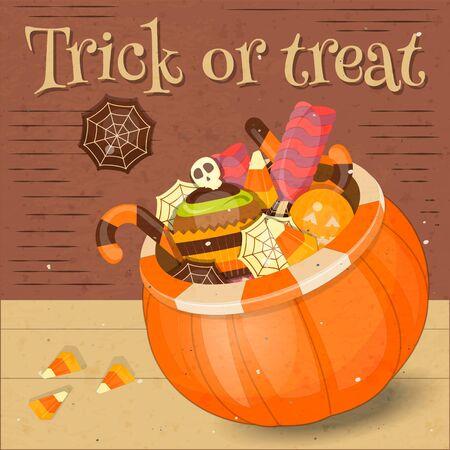 sweet treats: Jack-o-lantern Candy Basket with Pile of Colorful Halloween Sweet Treats. Halloween Pumpkin.