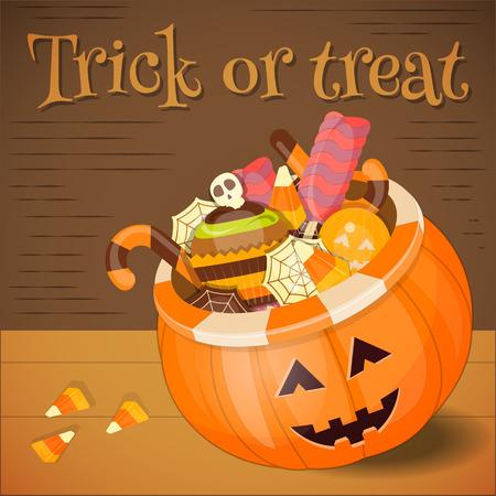 sweet treats: Jack-o-lantern Candy Basket with Pile of Colorful Halloween Sweet Treats. Halloween Pumpkin on Wooden Background.