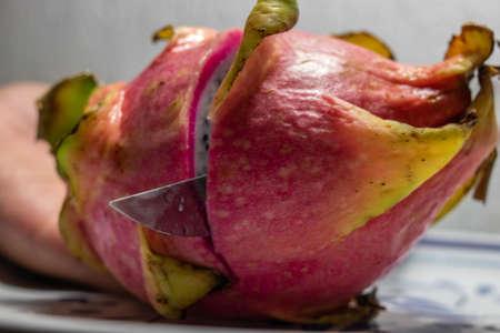 Pitaya, the dragon fruit being cut