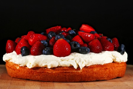 confiserie: Sponge cake with cream-cheese and fresh fruits and berries