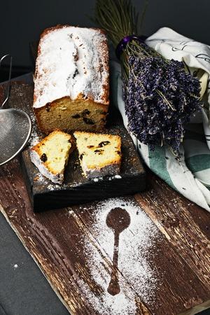 fruitcake: Traditional fruitcake with raisin on a cutting board