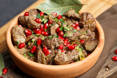 Fried Chicken Liver  with onions and pomegranate 스톡 콘텐츠