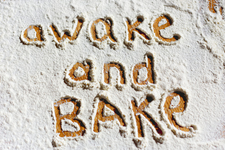 written: Words written in flour closeup Stock Photo