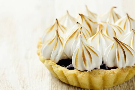 confiture: Tartlet with berry confiture and meringue horizontal close-up Stock Photo