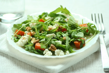 ruccola: Fresh ruccola salad with baked pumkin and goat cheese