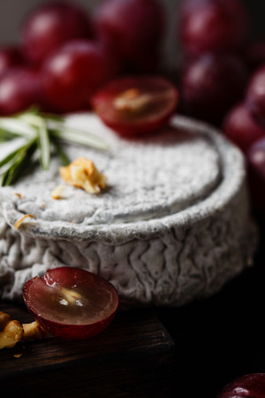 refinement: French Goat cheese with grape vertical close up Stock Photo
