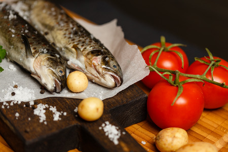 ingridients: Fresh raw fish and ingridients on wooden table