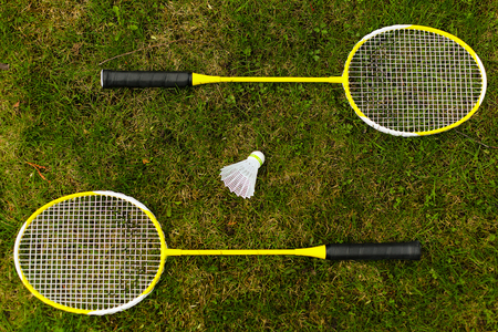 badminton racket: Badminton rackets on the green grass
