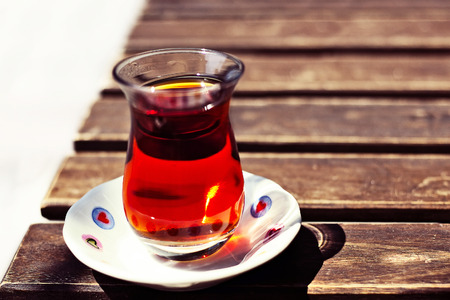 cup of tea: Turkish traditional cup tea on wooden table closeup